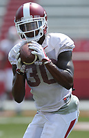 NWA Democrat-Gazette/ANDY SHUPE<br /> Arkansas defensive back Kevin Richardson II makes a catch Saturday, Aug. 5, 2017, prior to the start of a scrimmage in Razorback Stadium in Fayetteville. Visit nwadg.com/photos to see more photographs from the practice.