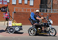 Disabled person on pimped up vehicle<br /> People head to the beach at the popular seaside resort of Skegness as England has it's hottest day of the year with temperatures well into the 30 degrees celcius. Kegness, England, UK on June 25, 2020.<br /> CAP/ROS<br /> ©ROS/Capital Pictures