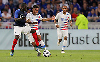 Lyon, France - Saturday June 09, 2018: Tyler Adams, N'Golo Kanté during an international friendly match between the men's national teams of the United States (USA) and France (FRA) at Groupama Stadium.