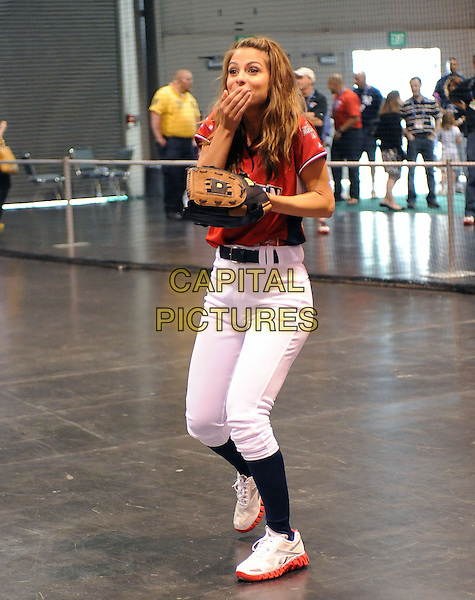 MARIA MENOUNOS.At the MLB All Star Fanfest Batting Practice held at The Anaheim Convention Center , the precursor to The All Star Legends Celebrity Softball game in Anaheim, California, USA..July 11th, 2010.full length red black top baseball mitt glove socks white trousers  hand covering mouth open funny sport.CAP/RKE/DVS.©DVS/RockinExposures/Capital Pictures.