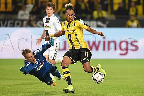 23.09.2016. Dortmund, Germany. German Bundesliga Football. Borussia Dortmund versus SC Freibrug. Alexander Schwolow ( Freiburg )dives to save from Pierre-Emerick Aubameyang ( Dortmund )