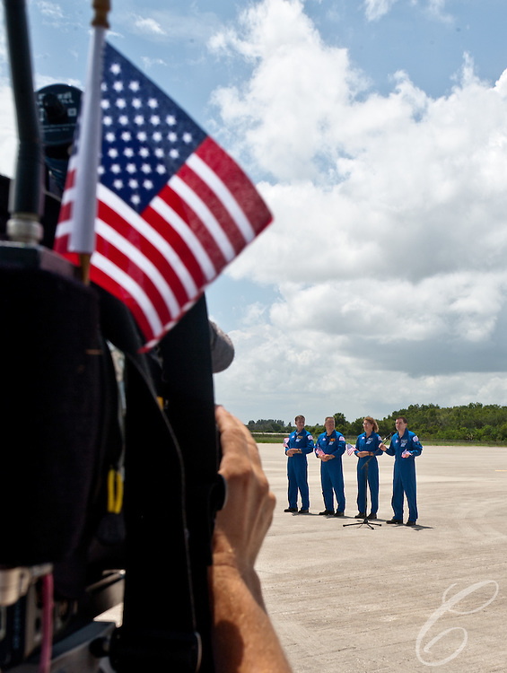 The crew of Space Shuttle Atlantis pose for photographs after arriving at Kennedy Space Center on Monday, July 4, 2011.  Pictured (from left) are Commander Chris Ferguson, Pilot Doug Hurley and Mission Specialists Sandy Magnus and Rex Walheim. Atlantis' mission is the final one of the program's 30 year history.