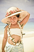 Young girl at the beach wearing lei
