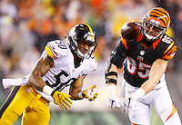 Ryan Shazier #50 of the Pittsburgh Steelers defends a pass to Tyler Eifert #85 of the Cincinnati Bengals during the Wild Card playoff game at Paul Brown Stadium on January 9, 2016 in Cincinnati, Ohio. (Photo by Jared Wickerham/DKPittsburghSports)