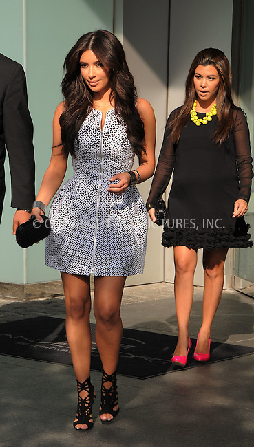 WWW.ACEPIXS.COM . . . . .  ....April 30 2012, New York City....TV personalities Kim Kardashian and Kourtney Kardashian leave their downtown hotel on the way to the E TV upfronts on April 30 2012 in New York City....Please byline: CURTIS MEANS - ACE PICTURES.... *** ***..Ace Pictures, Inc:  ..Philip Vaughan (212) 243-8787 or (646) 769 0430..e-mail: info@acepixs.com..web: http://www.acepixs.com