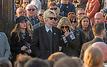 The  funeral of the late Prodigy singer Keith Flint at St Marys Church in Bocking,  Essex today. Mourners leaving the service.Rachel Howlett,  Gene Gallagher and Natalie Appleton (clutching order of service) can be seen leaving.