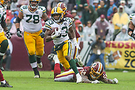 Landover, MD - September 23, 2018: Green Bay Packers running back Aaron Jones (33) runs the ball during the  game between Green Bay Packers and Washington Redskins at FedEx Field in Landover, MD.   (Photo by Elliott Brown/Media Images International)