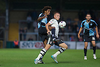 Sido Jombati of Wycombe Wanderers and Cauley Woodrow of Fulham battle for the ball during the Capital One Cup match between Wycombe Wanderers and Fulham at Adams Park, High Wycombe, England on 11 August 2015. Photo by Andy Rowland.