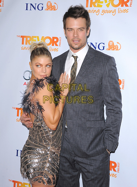 Stacy Ferguson - Fergie of Black Eyed Peas & Josh Duhamel .Trevor Live at The Hollywood Palladium in Hollywood, California, USA..December 4th, 2011  .half length dress  grey gray suit married husband wife  black pink beige feathers hair up bun side sequins sequined stubble facial hair  .CAP/RKE/DVS.©DVS/RockinExposures/Capital Pictures.