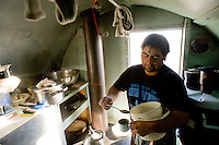"Chilean sheep herder Lorenzo Cortez Vargas washes and prepares hot water for a cup of mate in his ""campito,"" or small horse-drawn camp wagon, while watching a herd on Bureau of Land Management land outside Rock Springs, Wyo., Saturday, Feb. 7, 2009. Sheep herders working in southern Wyoming along the Colorado border complain of low pay, poor accomodations and lack of health care after they arrive on H2A visas to work for local ranchers. (Kevin Moloney for the New York Times)"