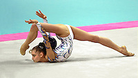 3 OCTOBER 1999 - OSAKA, JAPAN: Yulia Barsoukova of Russia performs with ball at the 1999 World Championships in Osaka, Japan. Yulia won bronze in the women's all around and went onto to become 2000 Olympic champion in rhythmic gymnastics.