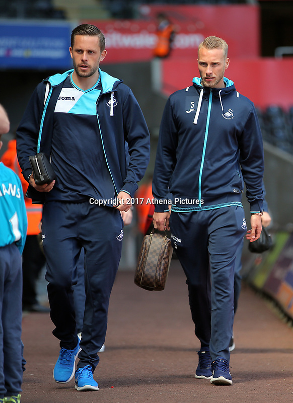 SWANSEA, WALES - APRIL 22: (L-R) Gylfi Sigurdsson and Mike van der Hoorn of Swansea City arrive prior to the Premier League match between Swansea City and Stoke City at The Liberty Stadium on April 22, 2017 in Swansea, Wales. (Photo by Athena Pictures/Getty Images)
