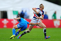 Charlotte Holland of Great Britain takes on the Italy defence. FISU World University Championship Rugby Sevens Women's 5th/6th place match between Great Britain and Italy on July 9, 2016 at the Swansea University International Sports Village in Swansea, Wales. Photo by: Patrick Khachfe / Onside Images