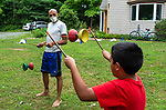 HARWINTON , CT-080620JS06—Joel Melendez, left, looks on as his son Rio Melendez-Kirchofer, 8, works on his Chinese Yo-Yo skills during the Thrive Movement Studio's circus camp Thursday at their studio in Harwinton. <br />  Jim Shannon Republican-American
