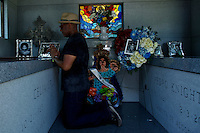 A fan prays inside of the queen of salsa Celia Cruz mausoleum during her  10th death anniversary in the Bronx in New York,  July 13, 2013. Photo by Eduardo Munoz Alvarez / VIEWpress.