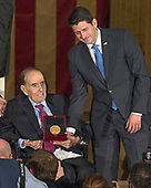 Speaker of the United States House Paul Ryan (Republican of Wisconsin), right, presents the Congressional Gold Medal to former US Senator Bob Dole (Republican of Kansas), left, in the Rotunda of the US Capitol on Wednesday, January 17, 2017.  Congress commissioned gold medals as its highest expression of national appreciation for distinguished achievements and contributions.  Dole served in Congress from 1961 through 1996, was the Senate GOP leader from 1985 through 1996, and was the 1996 Republican Party nominee for President of the United States.  <br />