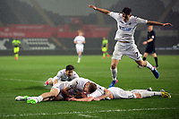 Pictured: Adam King of Swansea City is mobbed by team mates as he celebrates his second goal Monday 15 May 2017<br />