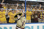 07 APR 2012:  Barry Almeida (9) of Boston College shows the trophy off to the fans after defeating Ferris State University during the Division I Men's Ice Hockey Championship held at the Tampa Bay Times Forum in Tampa, FL.  Boston College defeated Ferris State 4-1 to win the national title.  Matt Marriott/NCAA Photos