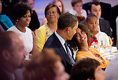 Washington, DC - July 21, 2009 -- Malia Obama (R) smiles at her father United States President Barack Obama during an event celebrating country music in the East Room of the White House in Washington DC, USA on 21 July 2009. Other members of the first family  pictured are First Lady Michelle Obama (L) her mother Marian Robinson (C) and daughter Sasha. Artists scheduled to perform included Charley Pride, Brad Paisley and Alison Krauss and Union Station. .Credit: Matthew Cavanaugh / Pool via CNP