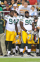 Aug. 28, 2009; Glendale, AZ, USA; Green Bay Packers defensive end (94) Jarius Wynn and tackle (90) B.J. Raji against the Arizona Cardinals during a preseason game at University of Phoenix Stadium. Mandatory Credit: Mark J. Rebilas-