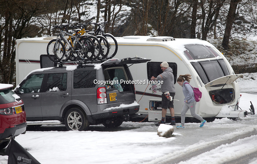 "28/03/16 <br /> <br /> Snow fall at Grin Low Caravan Site in Buxton. <br /> <br /> Holiday makers camping in the Derbyshire Peak District woke up to an unexpected white blanket this morning, thanks to Storm Katie.<br /> The covering of snow meant that many campers cut short their plans for a long weekend away, to brave the icy roads and head home early on Monday morning.<br /> But it wasn't all bad news for some of the younger guests at Grin Low Caravan Site in Buxton.<br /> Three-year-old Greta Williams made the most of the morning's surprise by building a snowman and enjoying snowball fights with her aunt Claire Jones. <br /> Claire said it was the first time she had been camping in the snow. <br /> ""It was completely unexpected but it's made it a trip to remember,""she said. <br /> ""Greta really enjoyed making the snowman, but I think we'll head back home now in case any more falls.""<br /> For Chris and Lorraine McCoy the first they knew of the snow was when they woke up and stuck their heads out of their tent.<br /> They had travelled to Buxton from Warwickshire with their four-year-old son Joe, to enjoy a weekend break.<br /> ""It's all part of the adventure,"" said Chris. ""It's a bit cold in the tent but we'll soon warm up, and it's made the surrounding countryside really beautiful.""<br /> <br /> All Rights Reserved: F Stop Press Ltd. +44(0)1335 418365   +44 (0)7765 242650 www.fstoppress.com"