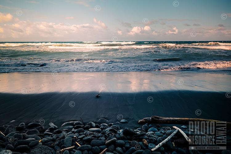 Pololu beach with waves and rocks on the North Kohala coastline of the Big island
