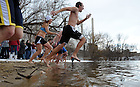 Students run into St. Joseph Lake Feb. 13, 2010 as part of the Polar Bear Plunge, a charity event to raise money for the Haiti earthquake relief...Photo by Matt Cashore/University of Notre Dame