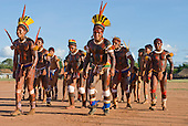 Xingu Indigenous Park, Mato Grosso State, Brazil. Aldeia Kuikuro - central village. Festival of Beija Flor; the whole village joins in the dance, elders, warriors, girls and boys.