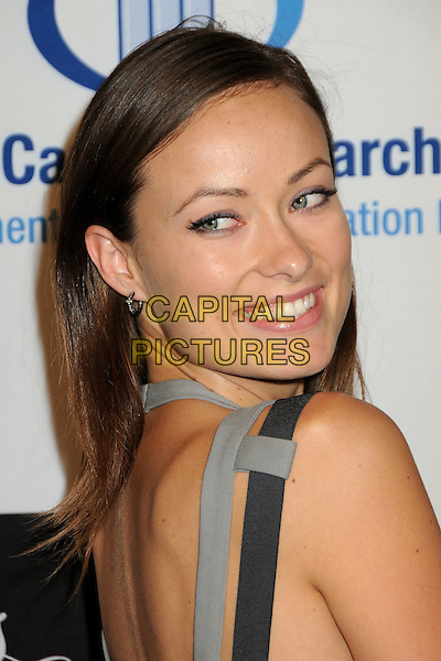 OLIVIA WILDE.EIF's Women's Cancer Research Fund Benefit held at the Beverly Wilshire Hotel, Beverly Hills, California, USA..January 27th, 2010.headshot portrait grey gray black strap looking over shoulder .CAP/ADM/BP.©Byron Purvis/AdMedia/Capital Pictures.