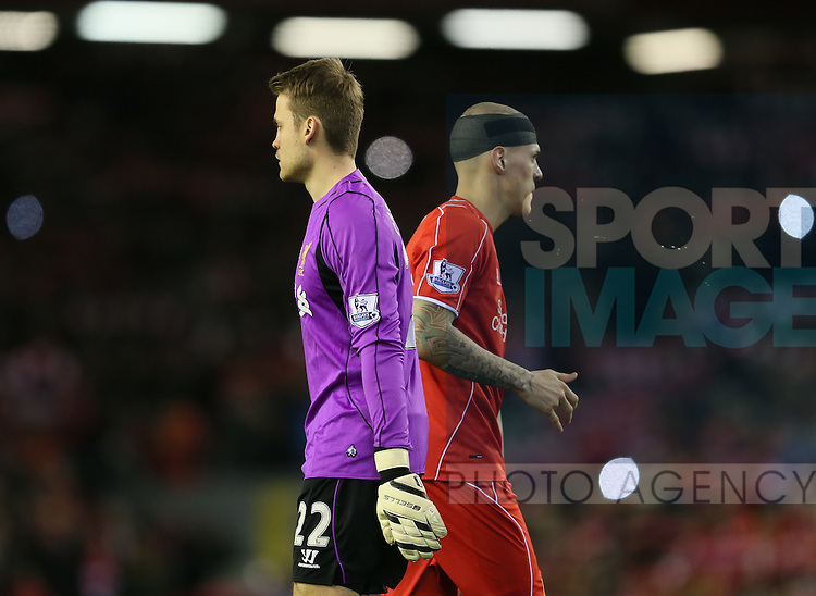 Simon Mignolet of Liverpool and Martin Skrtel of Liverpool pass by each other without speaking - Barclays Premier League - Liverpool vs Swansea City - Anfield Stadium - Liverpool - England - 29th December 2014  - Picture Simon Bellis/Sportimage