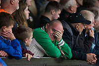 A Newport fan feels the tension during the Sky Bet League 2 match between Newport County and Notts County at Rodney Parade, Newport, Wales on 6 May 2017. Photo by Mark  Hawkins / PRiME Media Images.