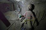 Old statues of &quot;El Tio&quot;  inside a mine in Potosi, Bolivia. El Tio (the Uncle) is considered by most miners here to be lord of the underworld. Miners bring offerings such as cigarettes, coca leaves, and alcohol for the statues, believing that if El Tio is not fed, he will take matters into his own hands. Above ground, most miners are Christians.<br /> <br /> In this mine, these old statues have been placed in a side tunnel, leaving one &quot;active&quot;  El Tio near the main entrance.