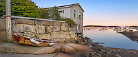 Stonington; Maine:; Wooden rowing pram on a rock shelf at low tide