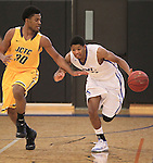 Southwestern Illinois College hosted the Jefferson Community and Technical College in an afternoon game on Saturday at the home of the Blue Storm. SWIC's De'Antae McMurray (4, right) dribbles the ball past Jefferson's Khalid Minor (30).
