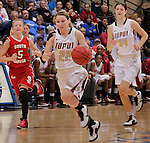 SIOUX FALLS, SD - MARCH 11:  Katie Comello races up the court trailed by teammate Nevena Markovic #34 and Alexis Yackley #5 of the University of South Dakota during their semifinal game at the 2013 Summit League Basketball Championships at the Sioux Falls Arena Monday.  (Photo by Dick Carlson/Inertia)