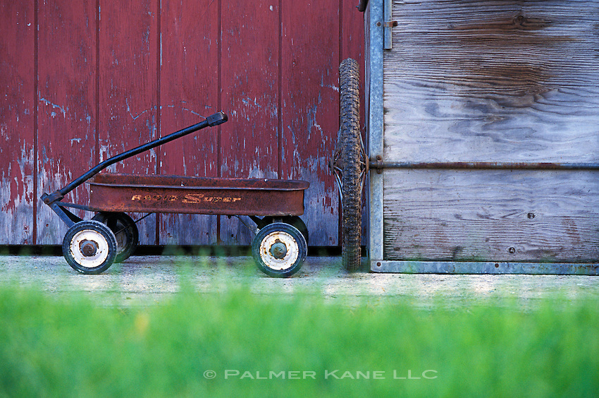 Rusty red wagon outside a Vermont barn