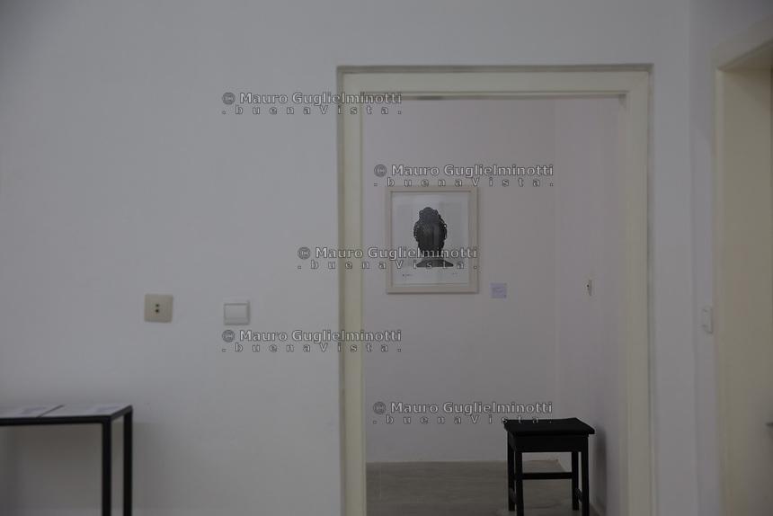 Stanza interna.coiffures des photographies de J.D'Okhai Ojeikere,