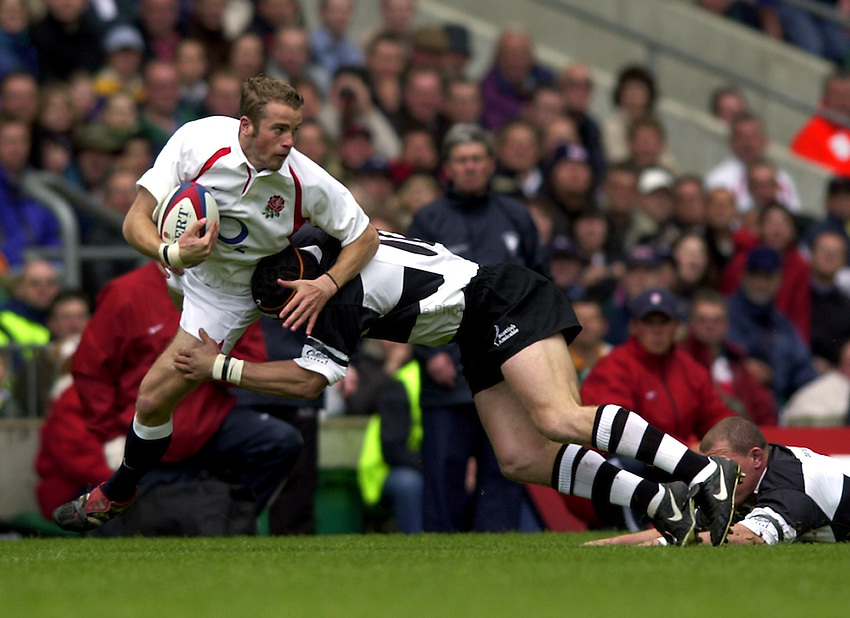 Photo. Richard Lane. .England v Barbarians at Twickenham.The Prudential Tour. 26-5-2002.James Simpson-Daniel breaks the Barbarian defence.