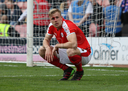 09.04.2016. Oakwell, Barnsley, England. Skybet League One. Barnsley versus Chesterfield. Barnsley's Marc Roberts is caught by the loose arm of Chesterfields Drew Talbot and receives a cut above his eye