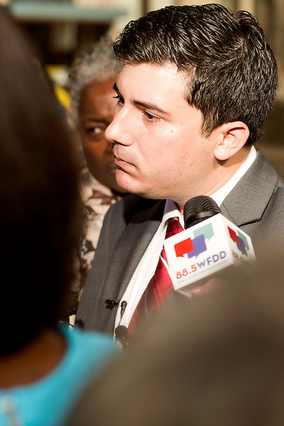 """July 13, 2015. Winston Salem, North Carolina.<br />  Ricky Diaz, the spokesperson for the North Carolina Republican Party, was questioned by the press after he announced the initiation of the party's """"Immoral Mondays"""" website. The site claims to expose the out of state funding of the Moral Monday events that have been popular with democratic voters over the last few years. <br />  A press conference was held outside the federal courthouse on the opening day of the North Carolina NAACP's case against Gov. Pat McCrory ( NC NAACP v. McCrory)<br />  The NC NAACP contests that HB 589 (Voter ID requirements) violate Section 2 of the Voting Rights Act (42 U.S.C. 1973) and the Fourteenth and Fifteenth Amendments of the Constitution."""