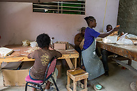 Haiti, Port-au-Prince. Artisan business, Papillon. Produce ceramics, jewelry, t-shirts. Over 300 women on payroll (men work her as well), making about $15 a day. Producing ceramic beads.