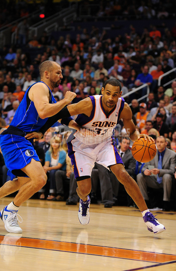 Mar. 27, 2011; Phoenix, AZ, USA; Phoenix Suns forward (33) Grant Hill drives to the basket against Dallas Mavericks guard Jason Kidd at the US Airways Center. The Maverick defeated the Suns 91-83. Mandatory Credit: Mark J. Rebilas-