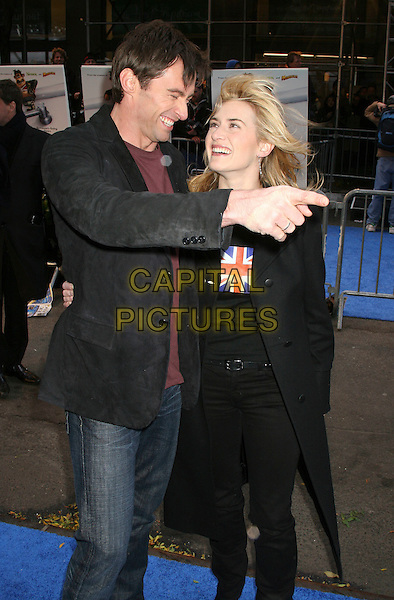 "HUGH JACKMAN & KATE WINSLET.Arrivals at the ""Flushed Away"" Premiere, held at the AMC Lincoln Square, New York, NY, USA, 29 October 2006..half length 3/4 hair blowing in wind messy windy funny hand pointing gesture union jack t-shirt top.Ref: IW.www.capitalpictures.com.sales@capitalpictures.com.©Ian Wilson/Capital Pictures"