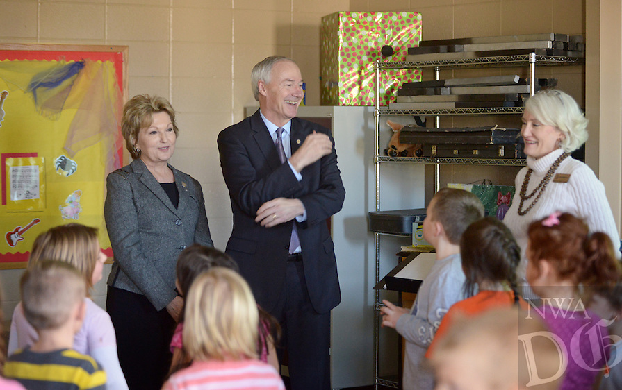 NWA Democrat-Gazette/BEN GOFF @NWABENGOFF<br /> Governor Asa Hutchinson and first lady Susan Hutchinson (left) visit with Janet Moreno's music class on Friday Jan. 15, 2016 at Glenn Duffy Elementary School in Gravette. The governor, who plays trumpet, and first lady, who is a pianist, watched the class rehearse a dance routine for an upcoming Valentine's Day celebration. The Gravette School District hosted the governor, originally from Gravette, and first lady for a 'Welcome Home Celebration' with stops at the high school, middle school and elementary school.