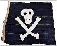 BNPS.co.uk (01202 558833)<br /> Pic: C&amp;T/BNPS<br /> <br /> A historic Jolly Roger flag hoisted above a D-Day ship during the Normandy invasion has surfaced 72 years later.<br /> <br /> The large black flag with a skull and crossbones emblazoned across it was the unofficial insignia for the crew of a coastguard ship that operated off 'bloody' Omaha Beach on June 6, 1944.<br /> <br /> Their job was to rescue soldiers who had had to bale out into the sea from their landing craft during the invasion.<br /> <br /> The 42ins by 47ins flag has now emerged for sale at auction for &pound;1,500.