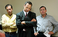 TALLAHASSEE, FL. 7/16/03-Sens. Alex Diaz de la Portilla, R-Miami, left, Tom Lee, R-Brandon, and Ken Pruitt, R-Port St. Lucie listen as Senate President Jim King, R-Jacksonville, talks about Gov. Jeb Bush turning up the pressure on the Senate come around to his point of view on the medical malpractice insurance reform bill Wednesday during a news conference at the Capitol in Tallahassee. COLIN HACKLEY PHOTO