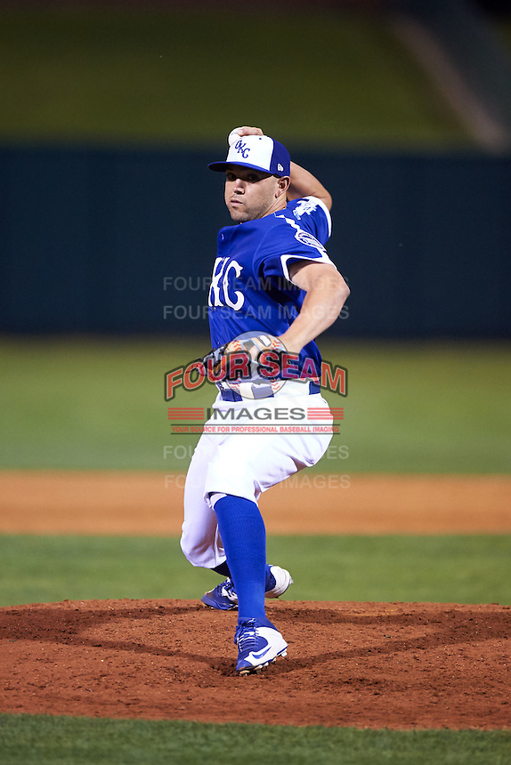 Oklahoma City Dodgers catcher Ralph Henriquez (2) takes the mound to pitch during a game against the Fresno Grizzles on June 1, 2015 at Chickasaw Bricktown Ballpark in Oklahoma City, Oklahoma.  Fresno defeated Oklahoma City 14-1.  (Mike Janes/Four Seam Images)