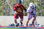 Los Angeles, CA 04/01/16 - Justin Collier (USC #20) and Owen McNiff (Loyola Marymount #13) in action during the University of Southern California and Loyola Marymount University SLC conference game  USC defeated LMU.