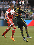Jun 6, 2015; Portland, OR, USA; New England Revolution defender Chris Tierney (8) and Portland Timbers midfielder/forward Dairon Asprilla (11) go after a ball during the second half of the game at Providence Park. The Timbers won the game 2-0. Mandatory Credit: Steve Dykes-USA TODAY Sports