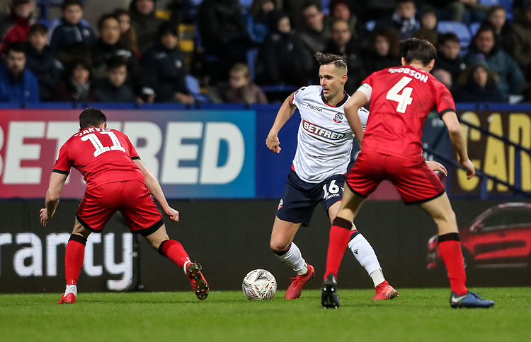 Bolton Wanderers' Pawel Olkowski competing with Walsall's Matt Jarvis and George Dobson<br /> <br /> Photographer Andrew Kearns/CameraSport<br /> <br /> Emirates FA Cup Third Round - Bolton Wanderers v Walsall - Saturday 5th January 2019 - University of Bolton Stadium - Bolton<br />  <br /> World Copyright © 2019 CameraSport. All rights reserved. 43 Linden Ave. Countesthorpe. Leicester. England. LE8 5PG - Tel: +44 (0) 116 277 4147 - admin@camerasport.com - www.camerasport.com